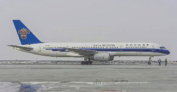 A jet plane is seen ready to take off, heading to Kaohsiung,Taiwan, from Urumqi, capital of Northwest China's Xinjiang Uygur Autonomous region, March 12, 2013.