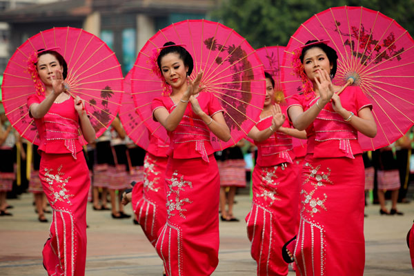 Performers dance at the Water Splashing Festival in Jinghong, April 15, 2013